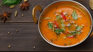 Indian red curry in copper bowl