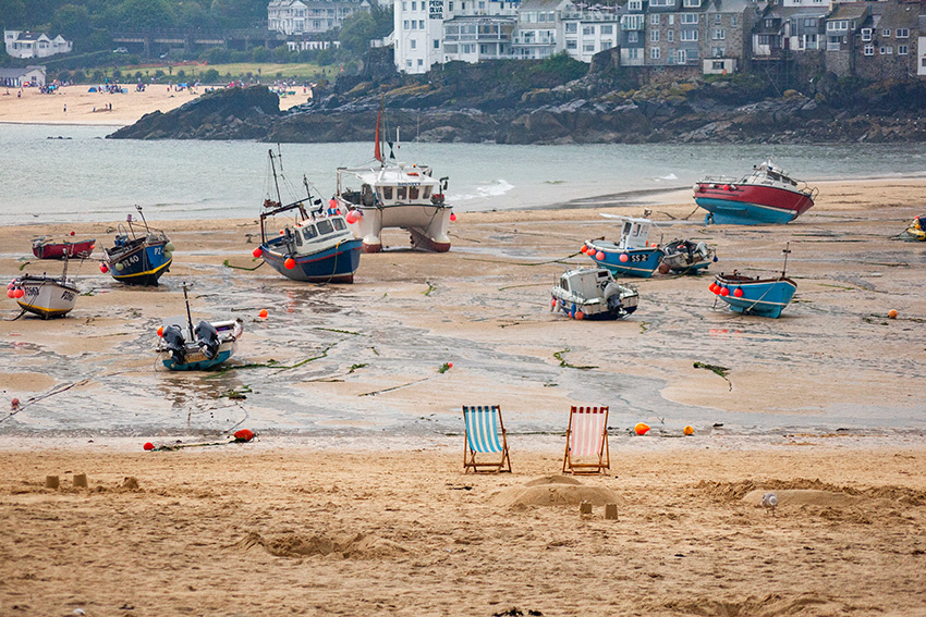 Cornwall beach with boats on the sand