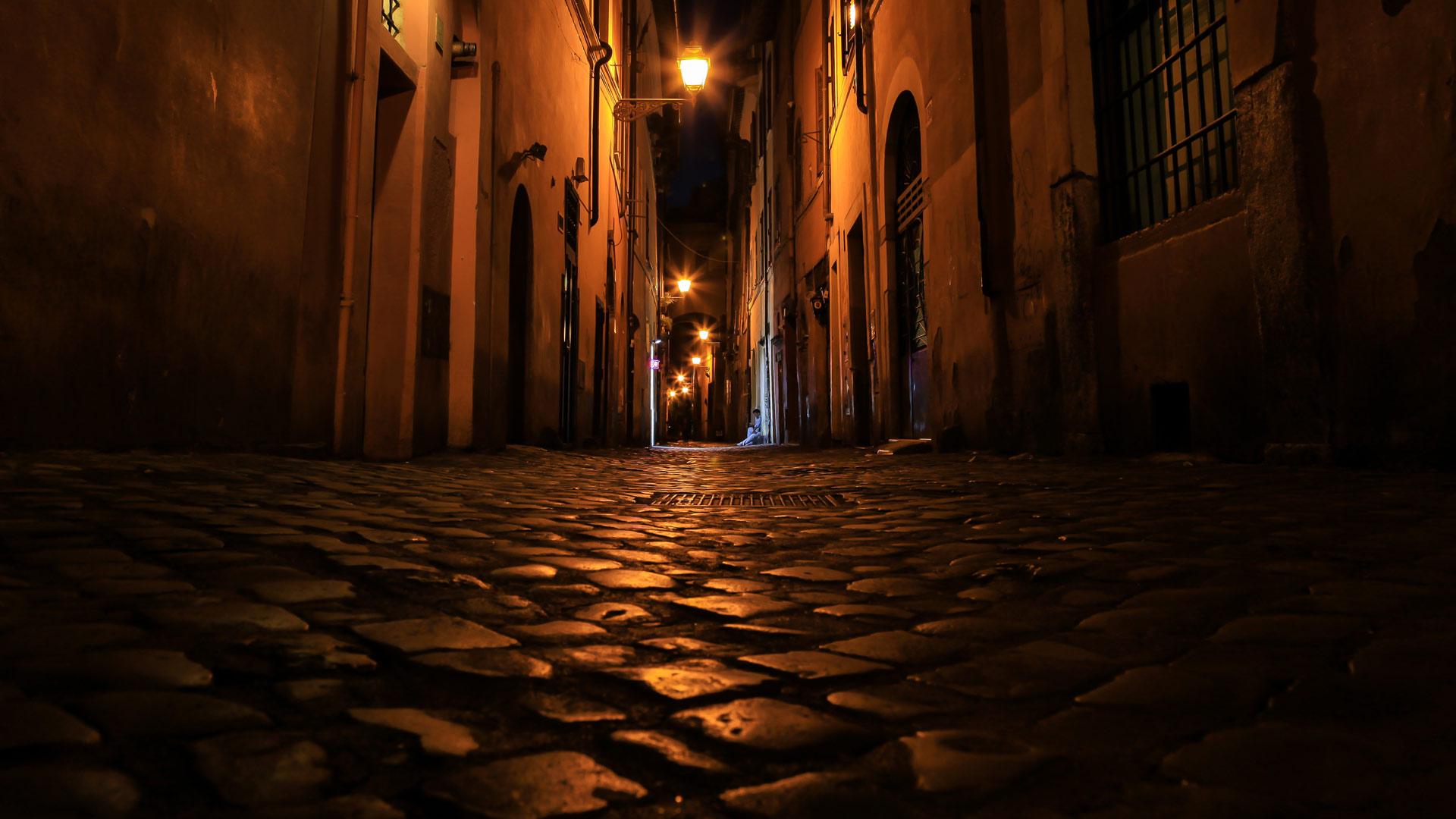 cobblestone back street at night
