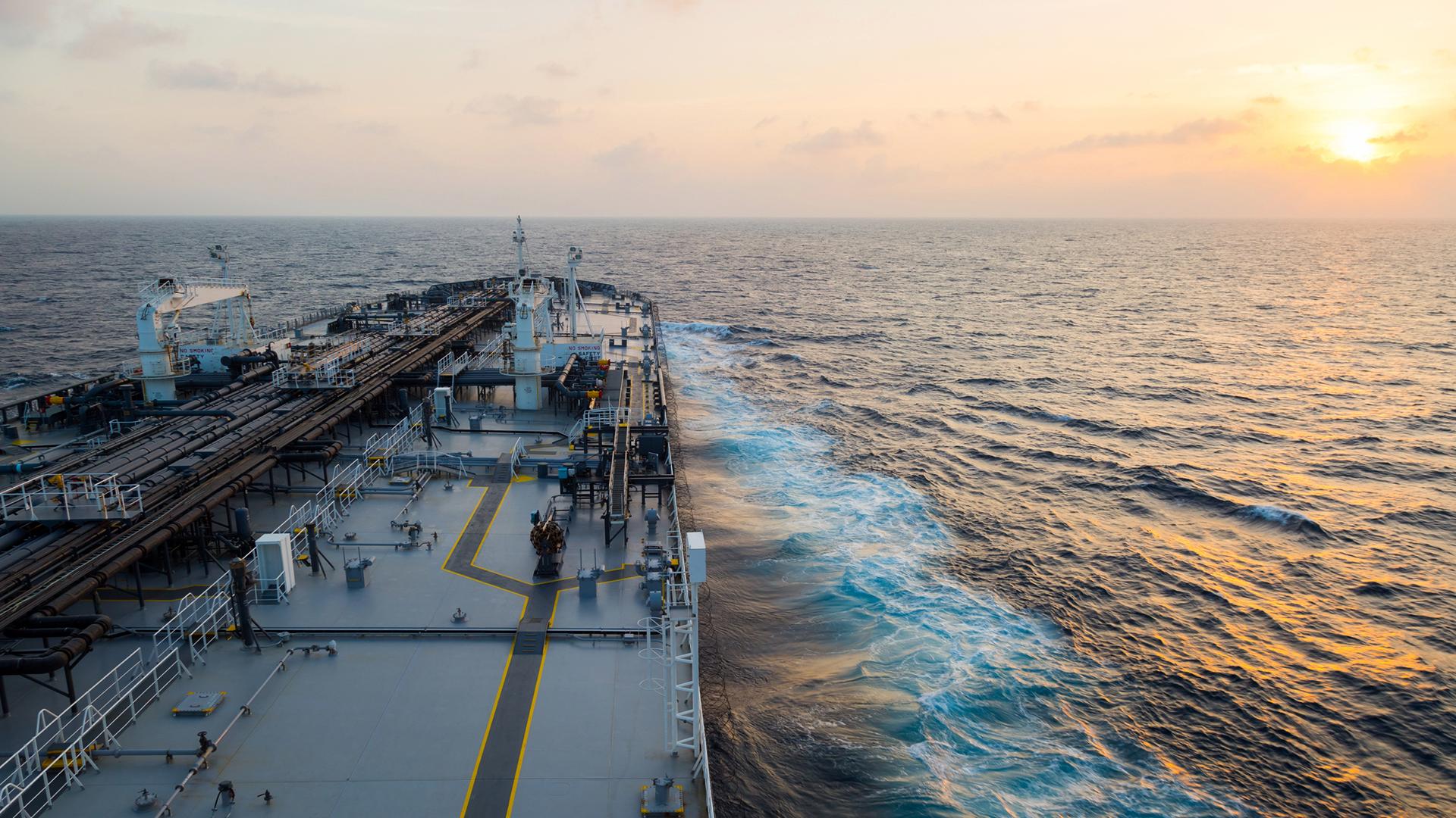 Big grey oil tanker underway in the open sea