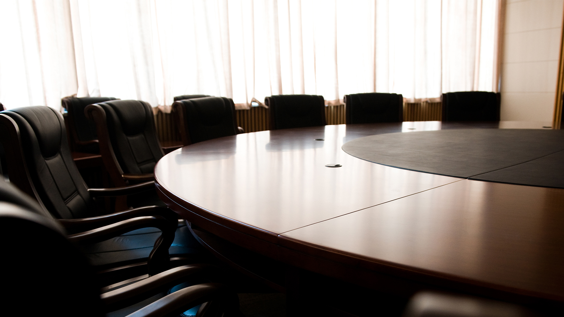 Board-directors-meeting-planning-panel-chairs-table