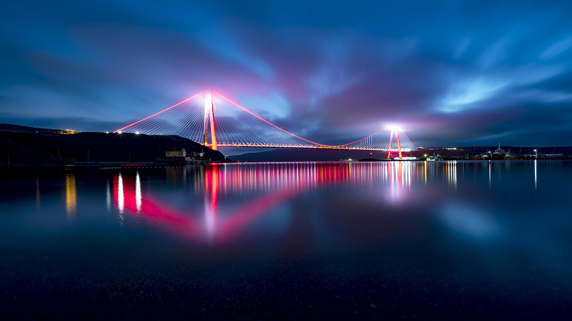 pink bridge over water inside turkey banner