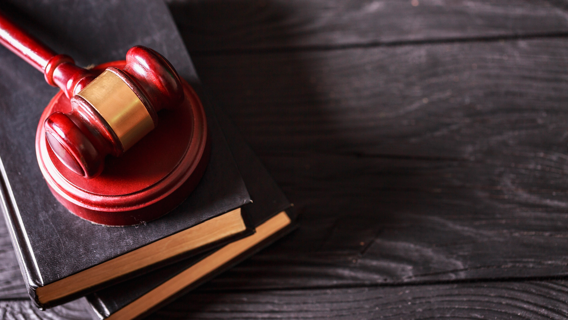 A gavel over books on a table