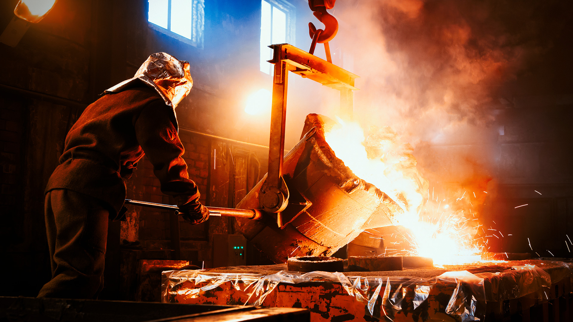 man-pouring-hot-iron-to-mold