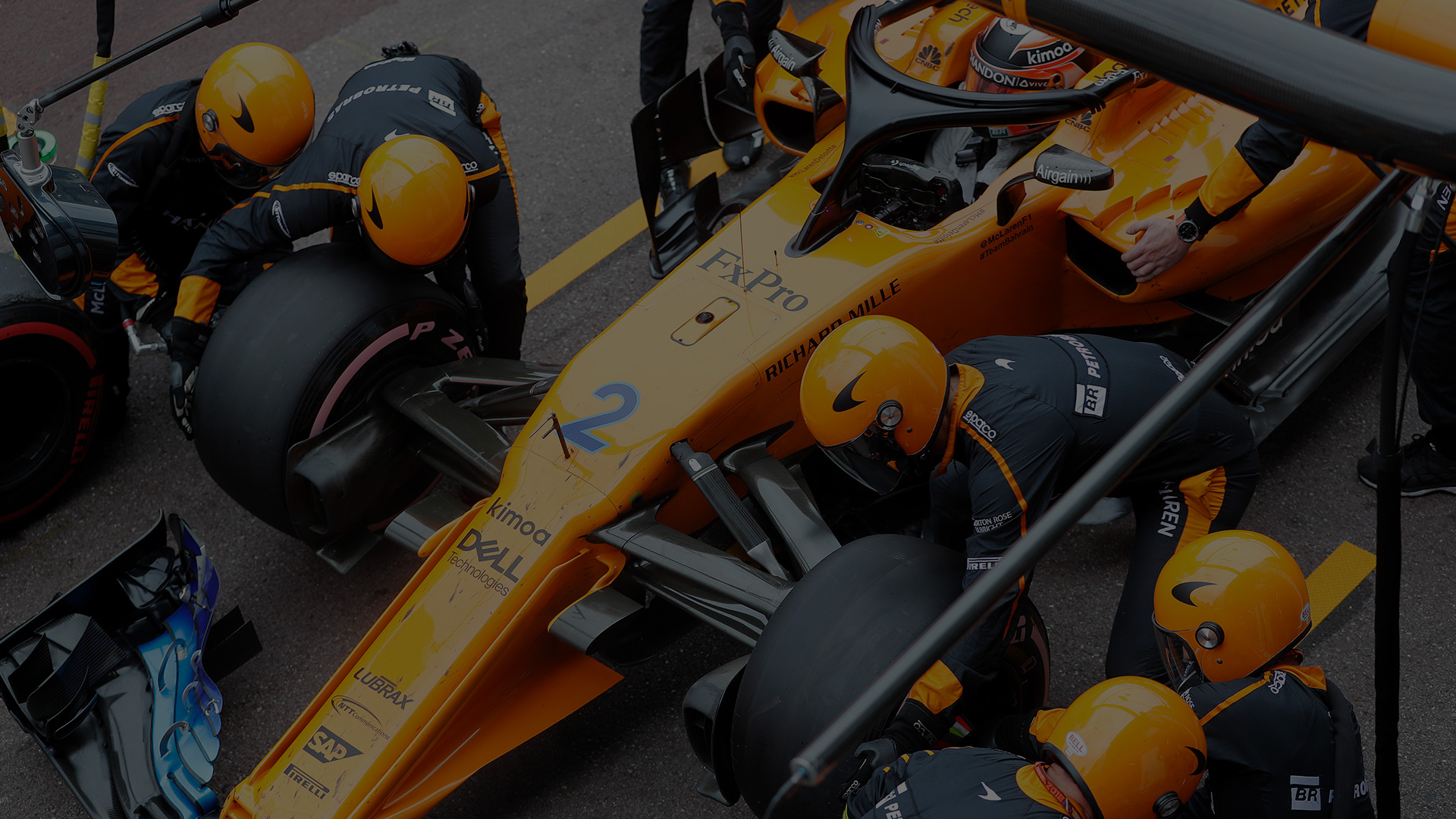 McLaren race car with pit stop team