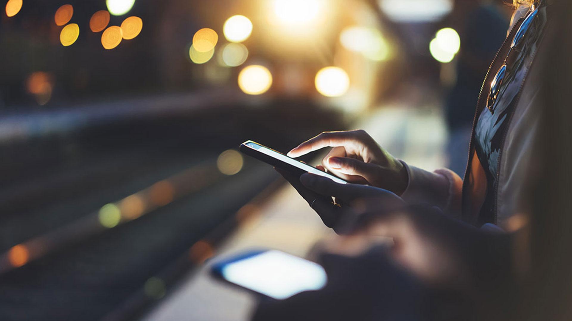 People near tracks using phones