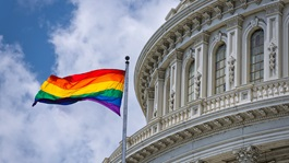 Pride flag flying next to US Capitol building