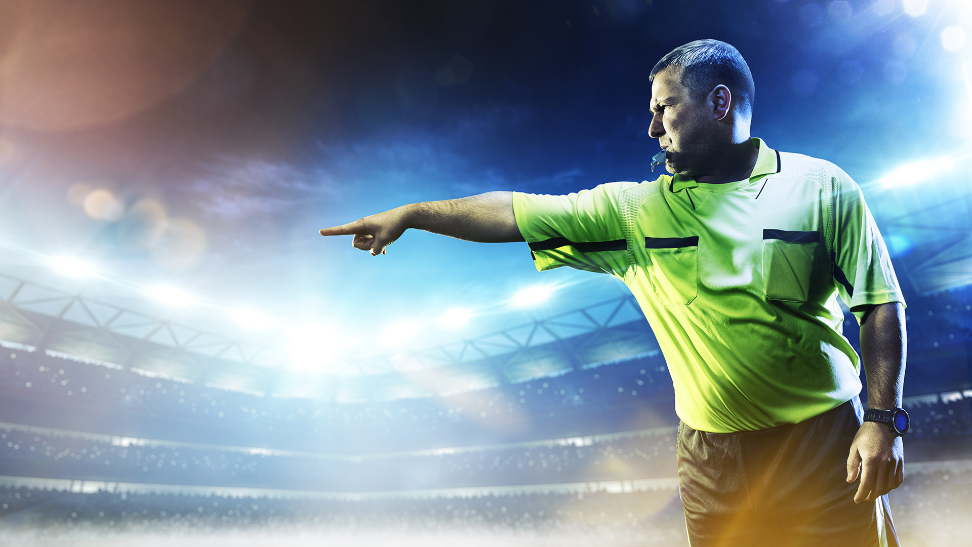 Sports referee pointing and whistling
