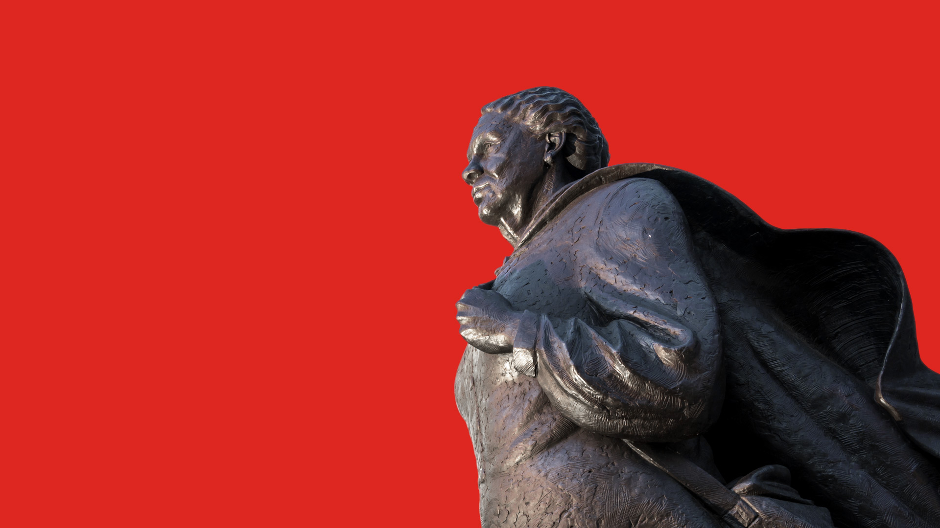 statue on red background