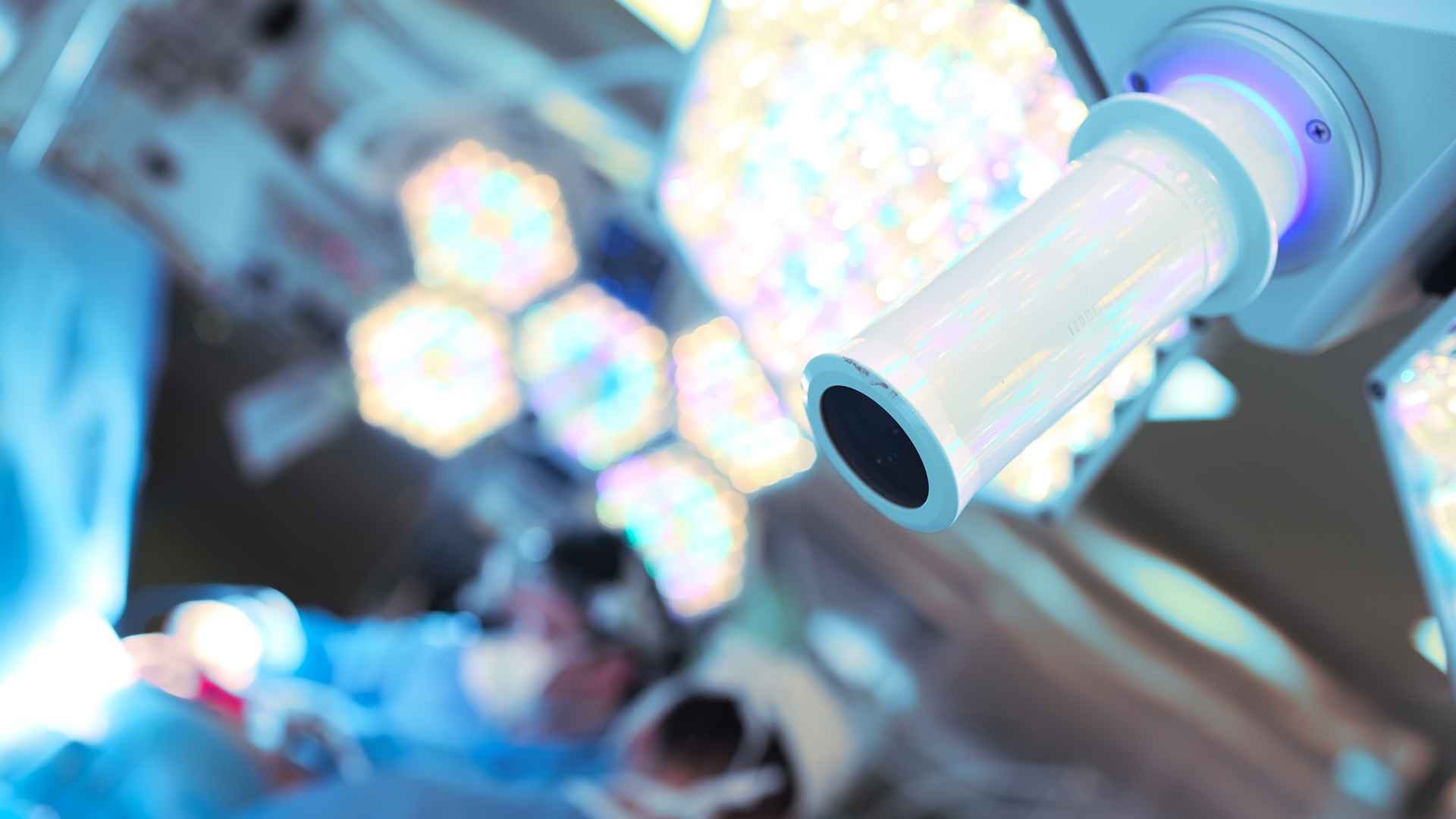 Blurred surgeons and focused surgery lamp in operating room
