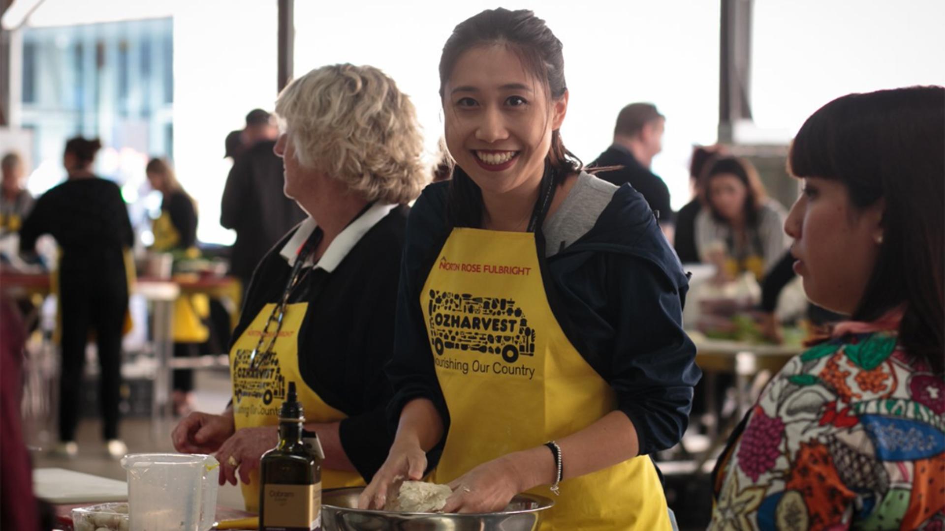 Woman wearing a yellow apron