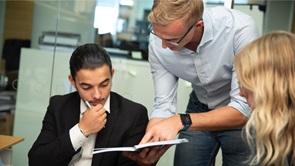 man teaching his colleagues