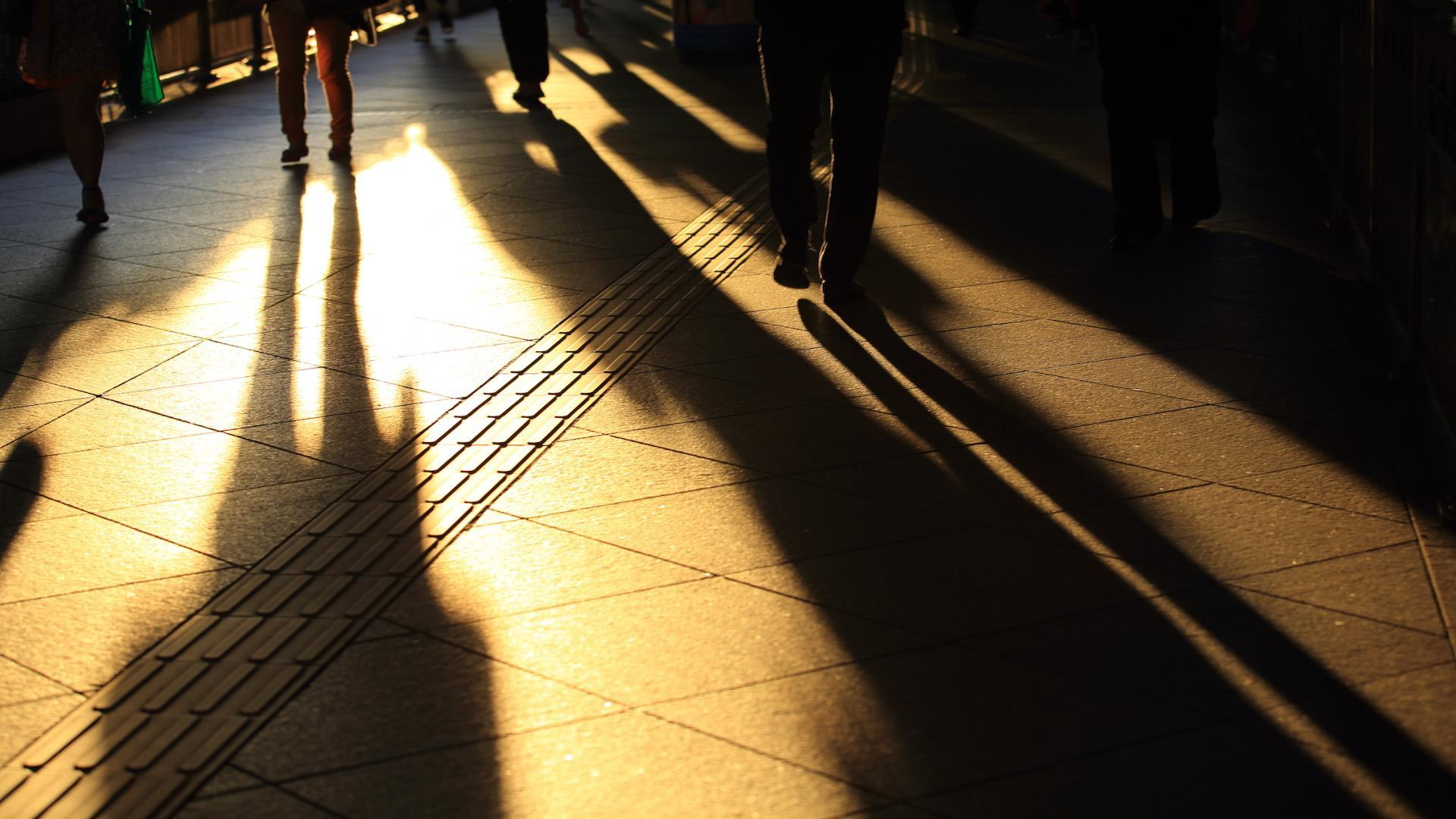 People walking in shadow