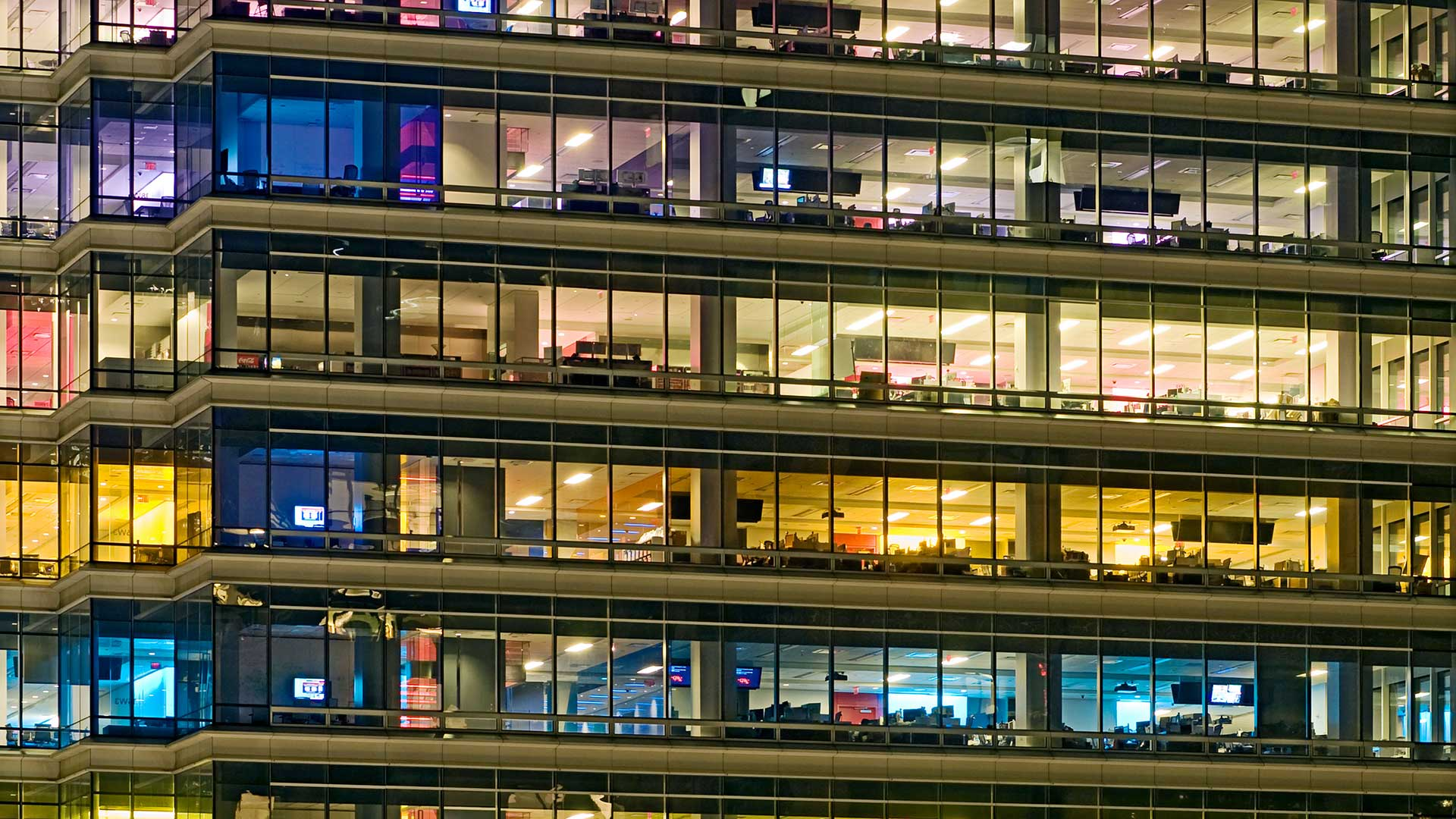 Image of colorful office building at night