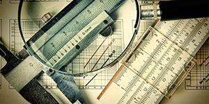 slide ruler magnifying glass statistics charts