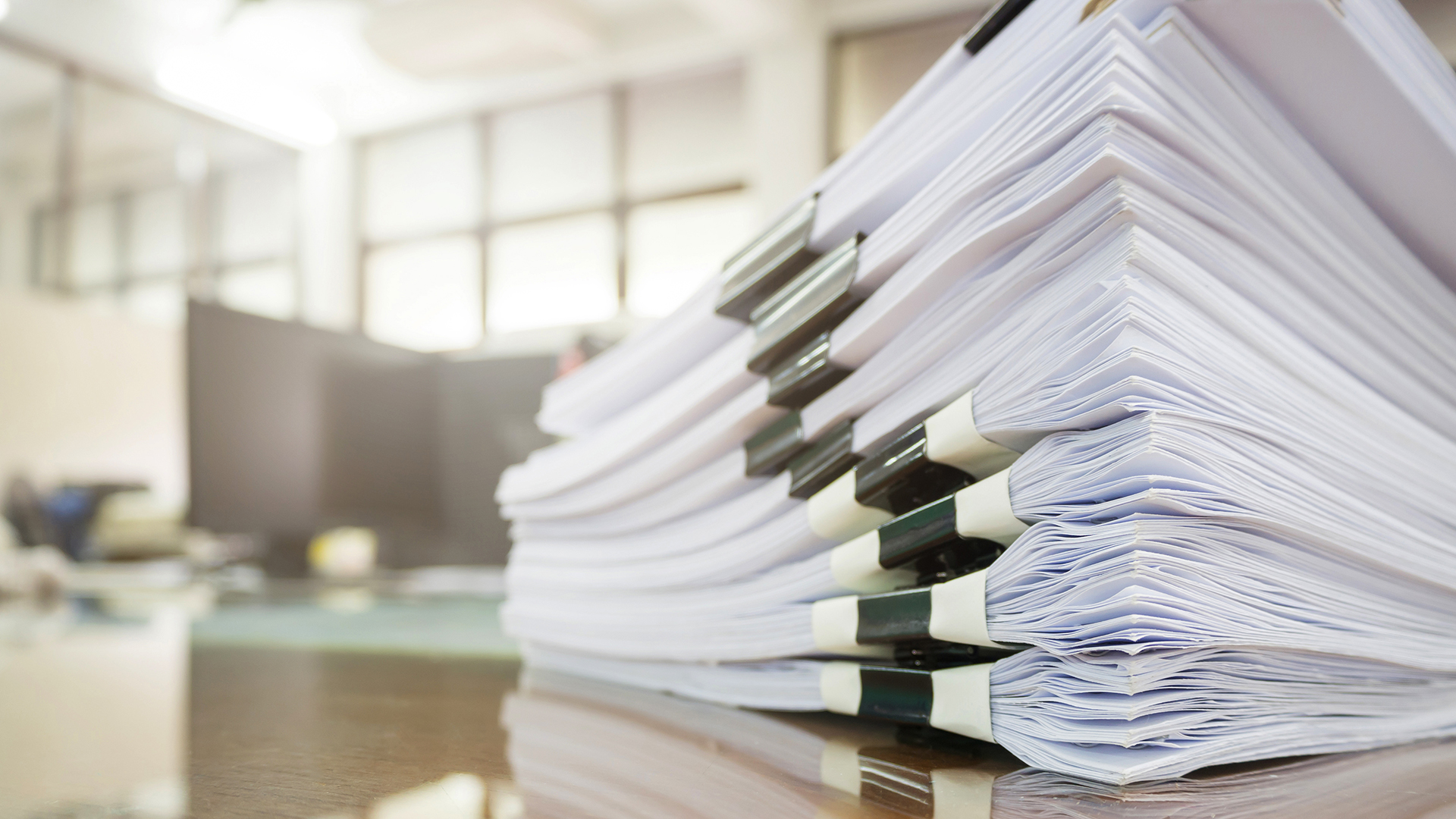 Stack of documents on a desk