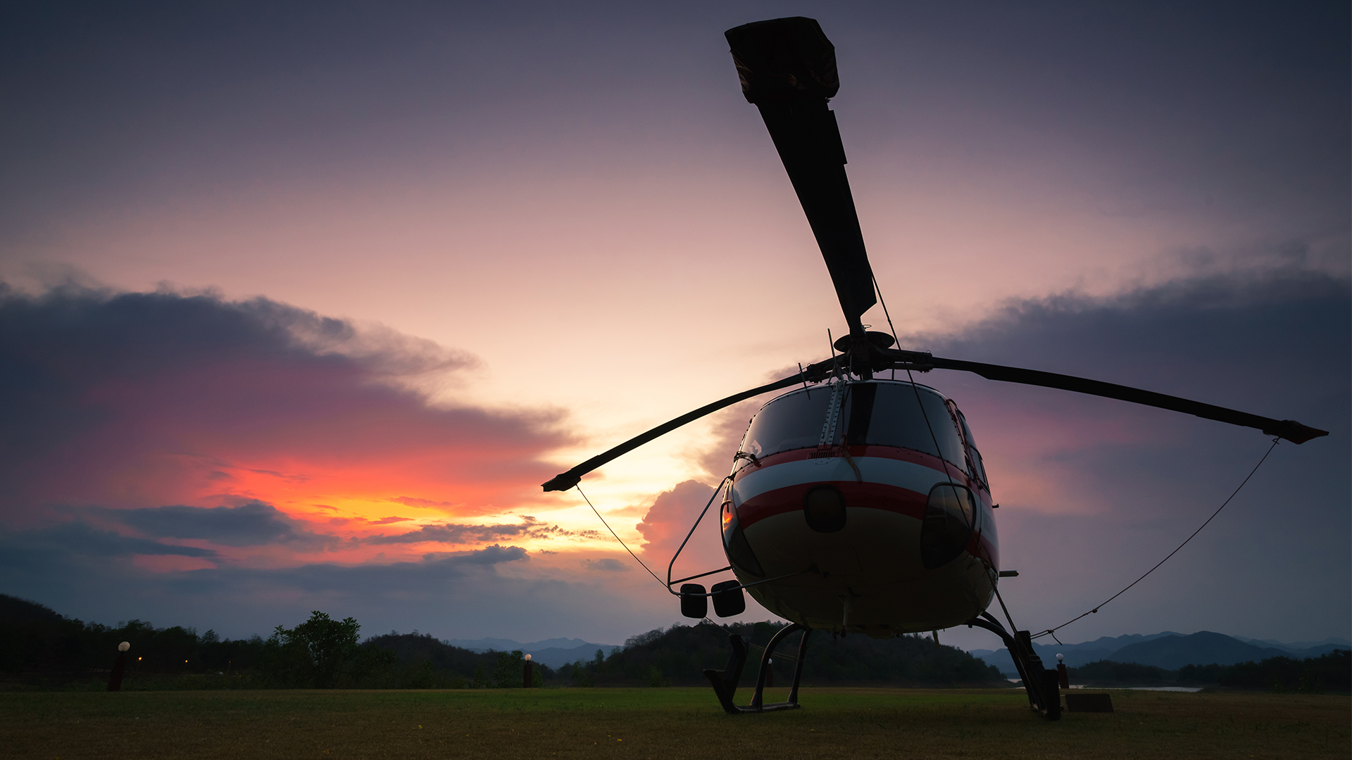 helicopter lifting off ground