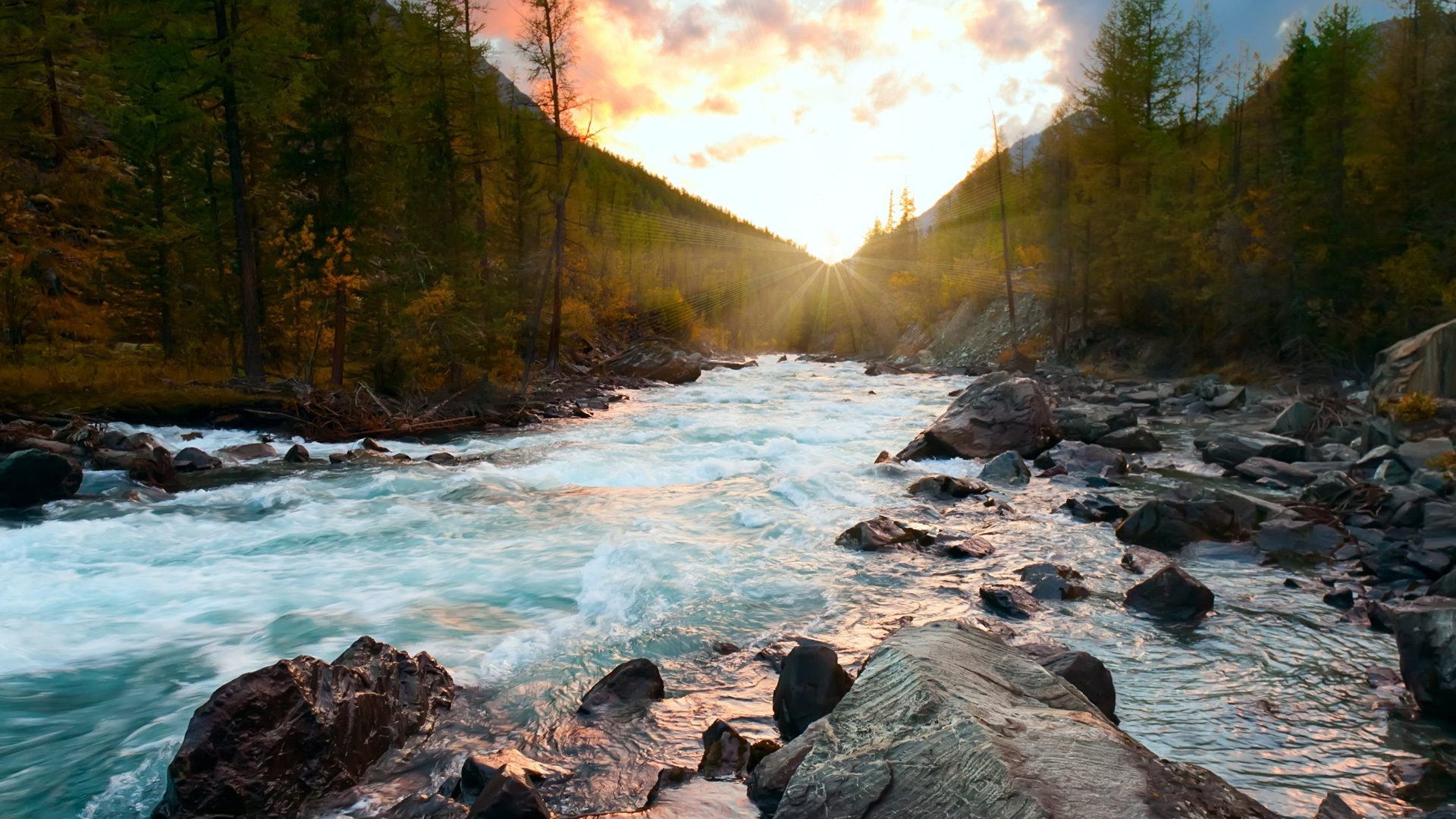 River in northern Canada flowing with sunset