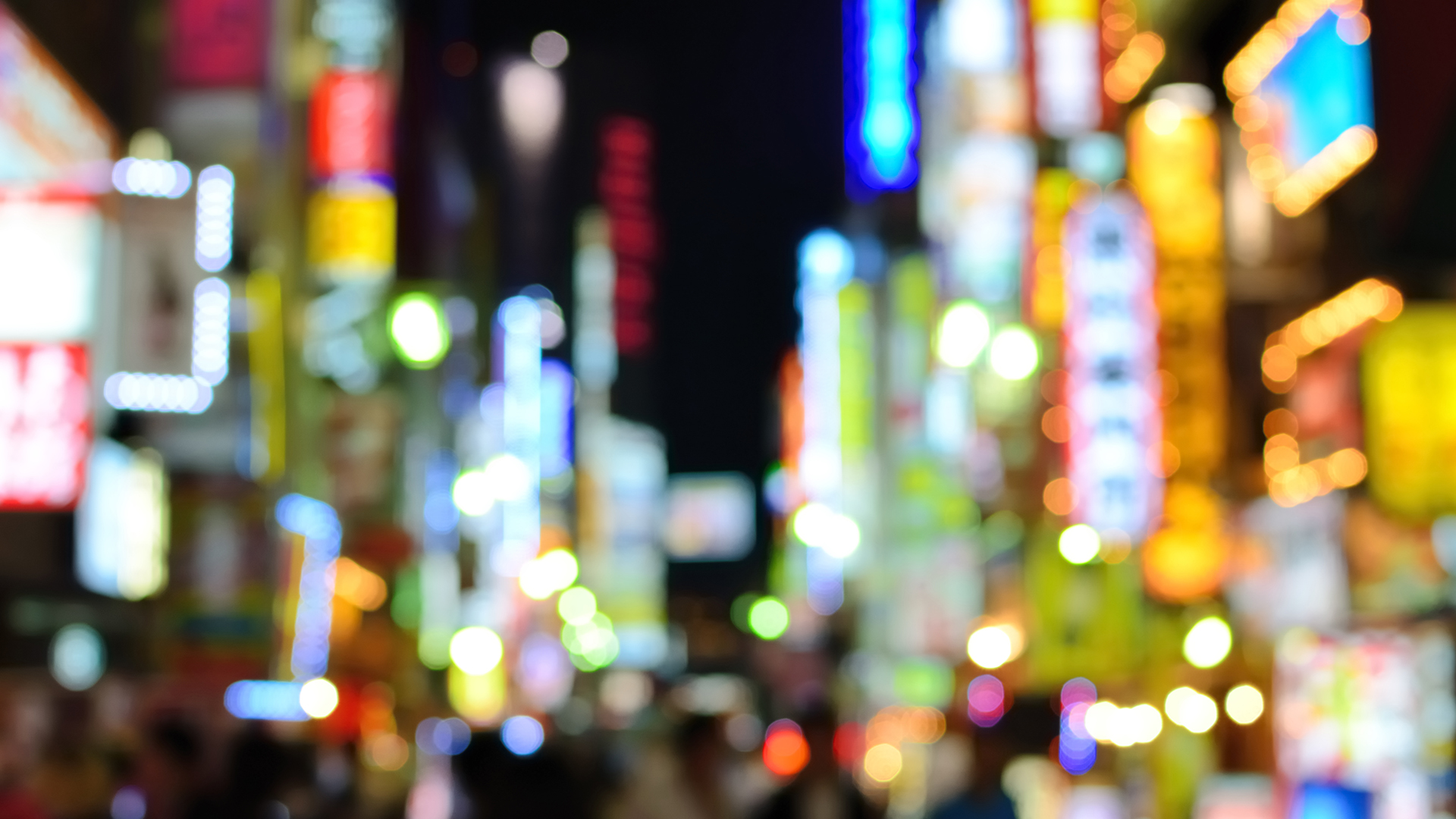 blurred colourful city lights at night time