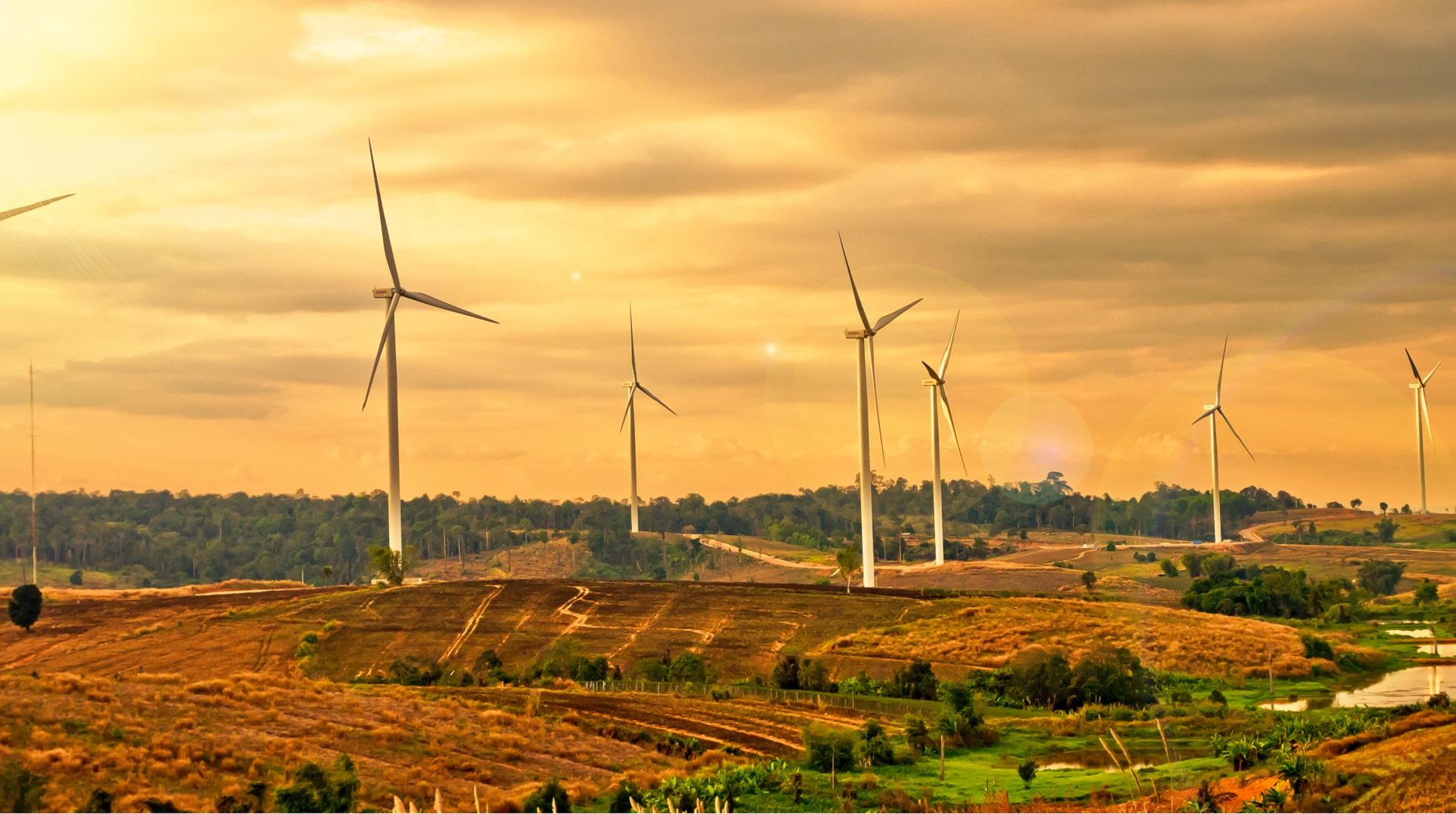 wind farm turbines on green hill
