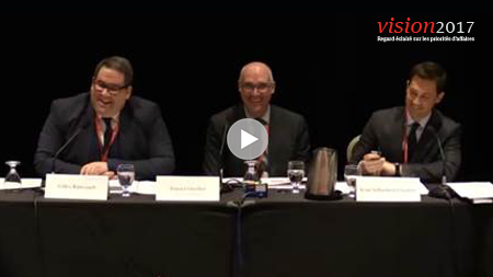 3 speakers at a panel presentation