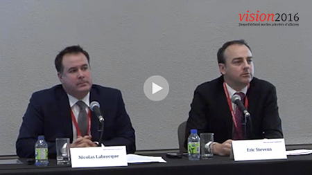 two speakers at a panel presentation