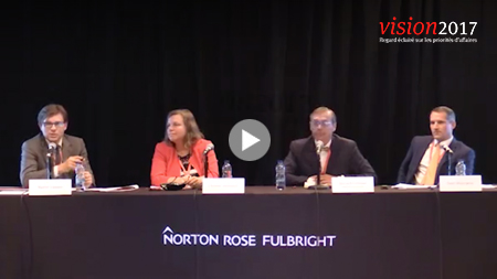 4 speakers at a panel presentation