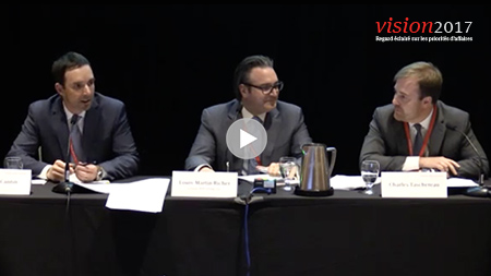 3 men presenting at conference