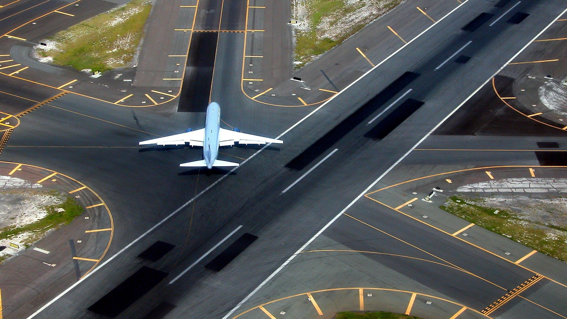 Airport runway with plane