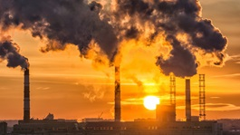 industrial smoke at sunset