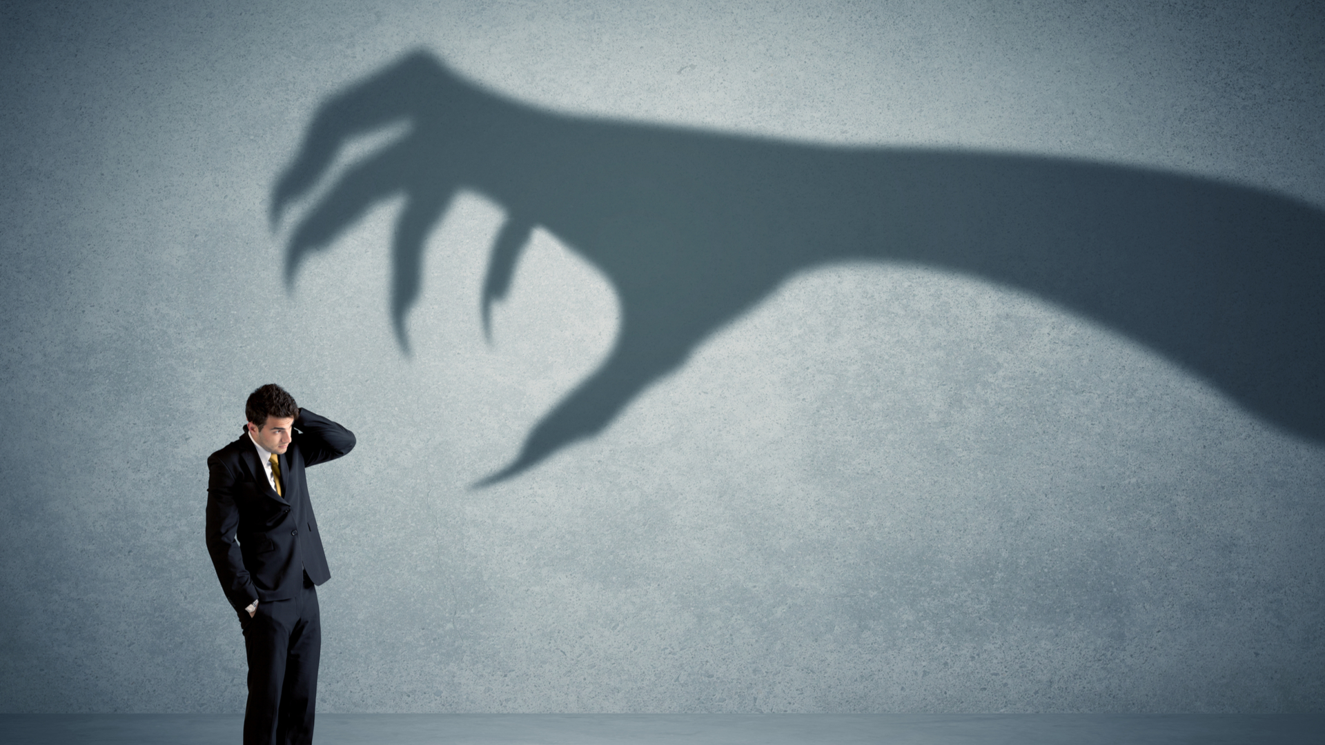 director businessman with scary shadow hand