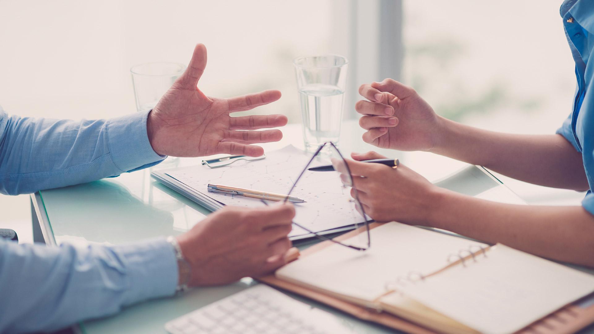 hands at desk