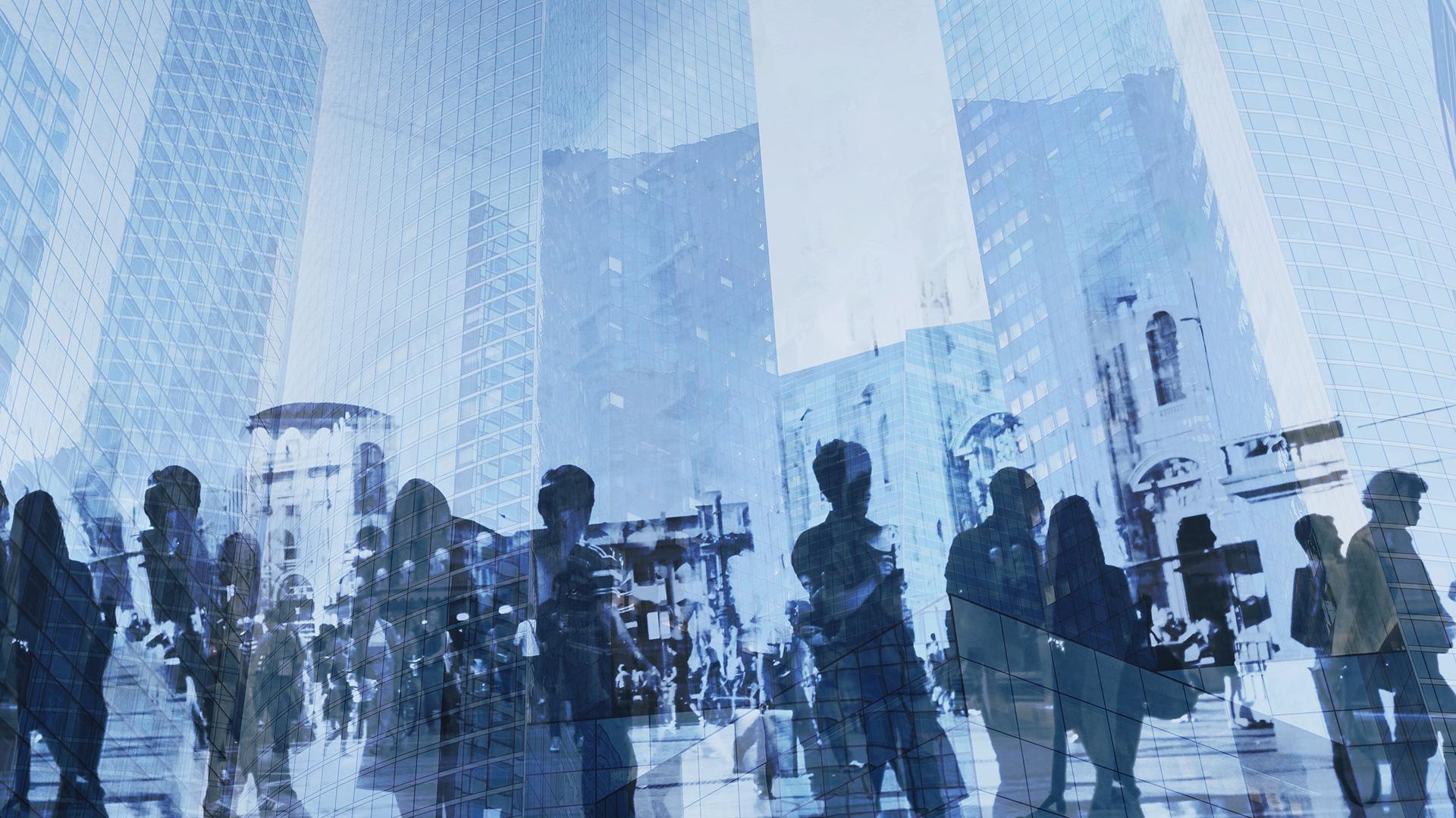 dark shadows people in front of blue buildings