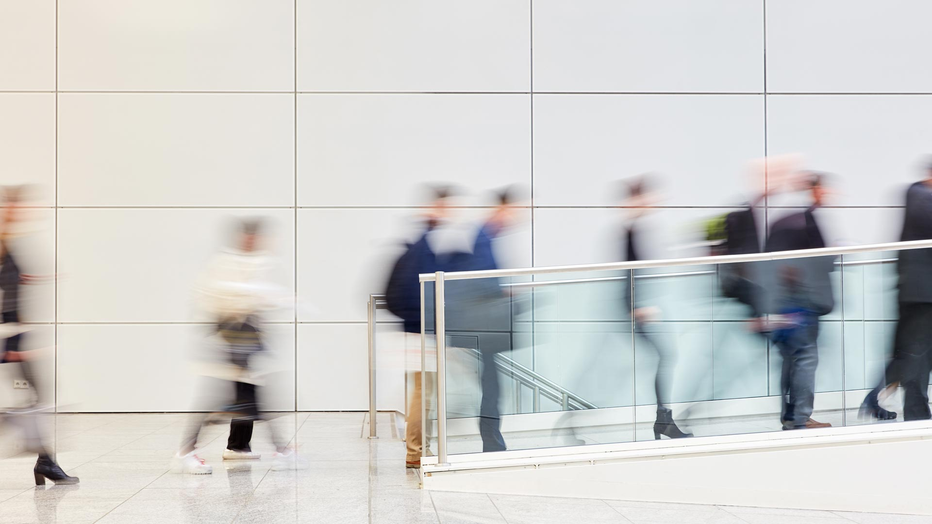 employees in a line going up walkway