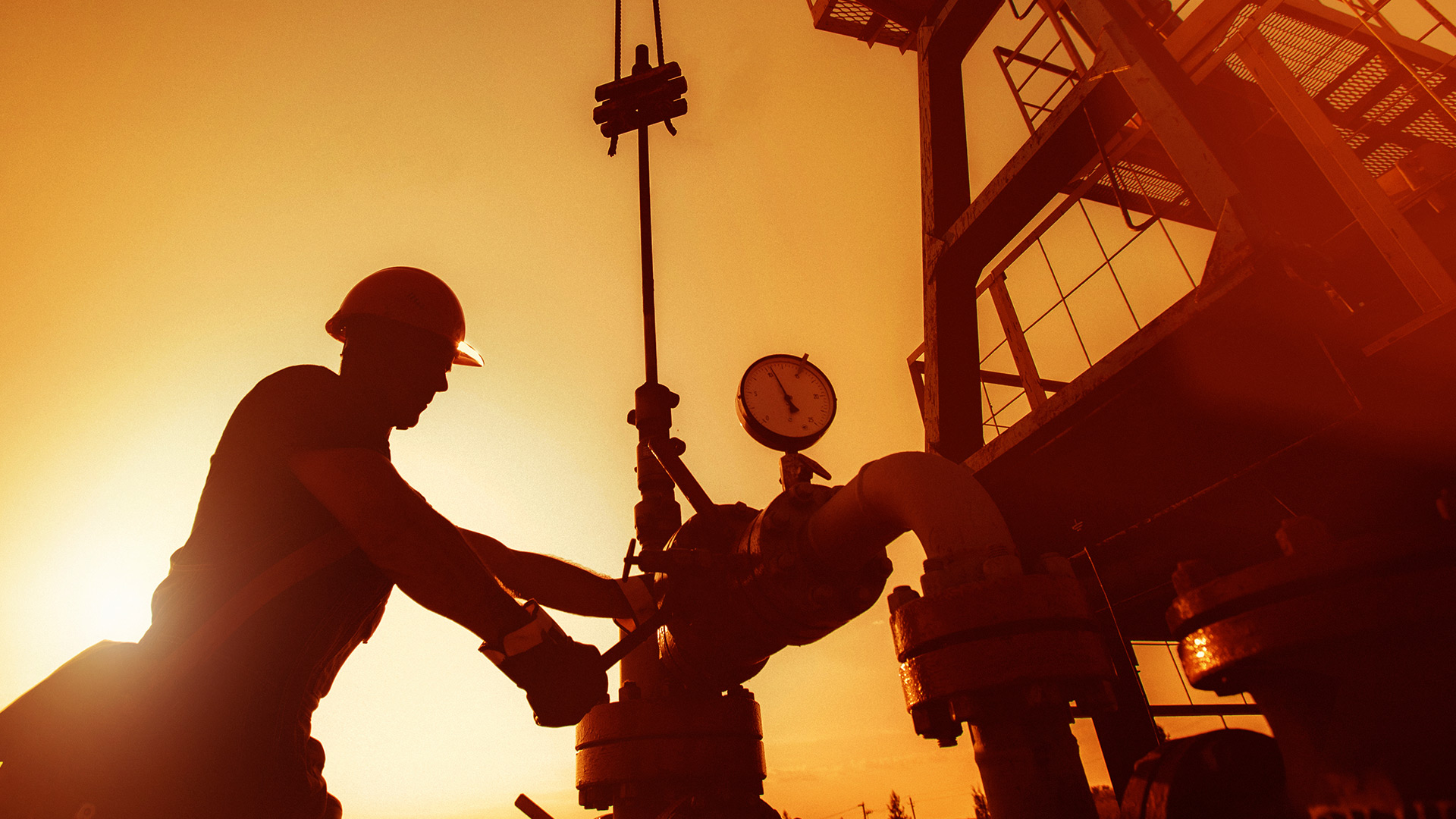 Oil worker checking the oil pump