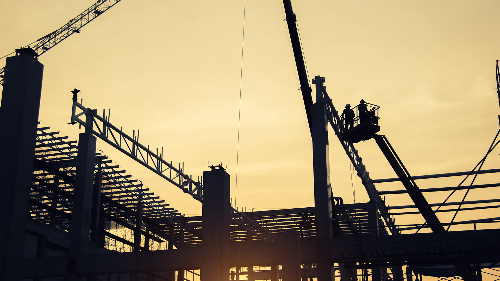 Silhouette of a crane and scaffolding on a construction site
