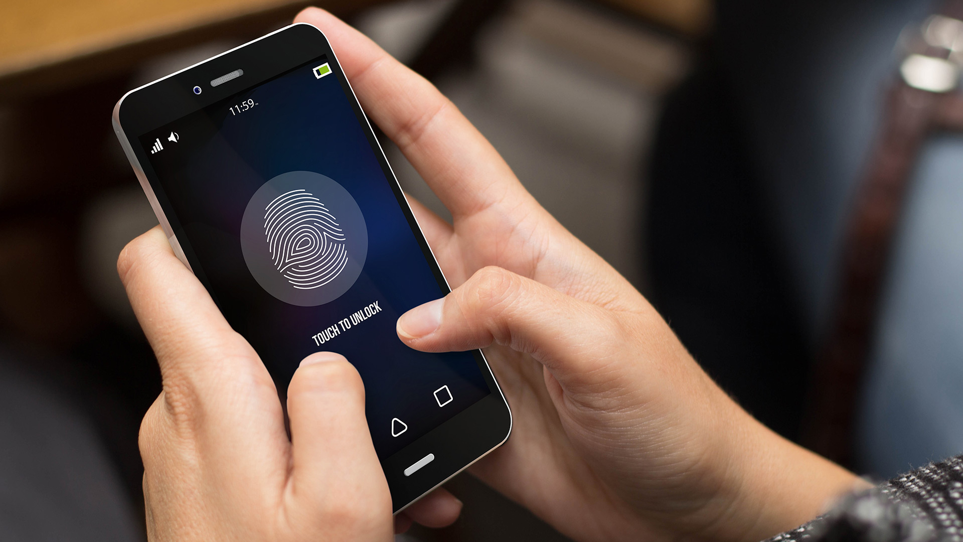 Cellphone in hands with fingerprint ID lock screen