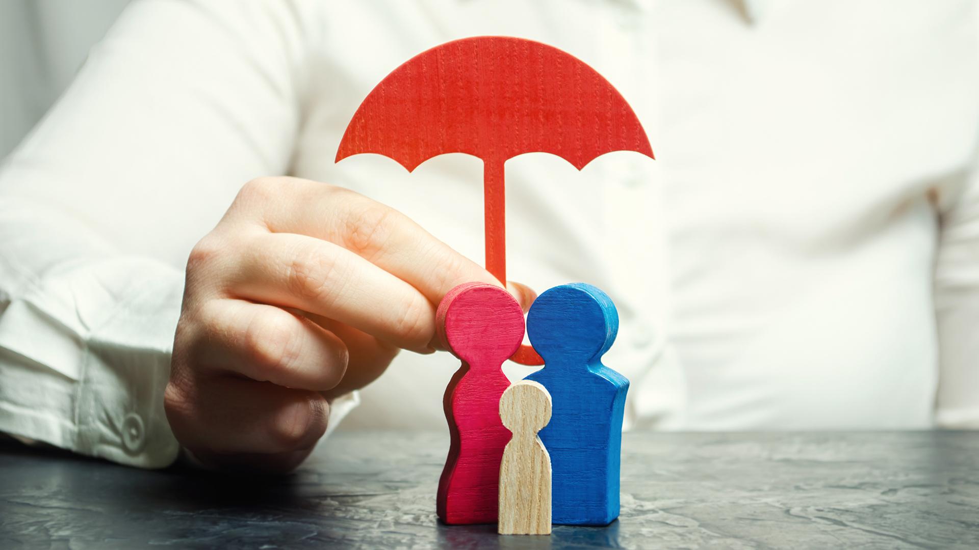 Wooden block family under umbrella