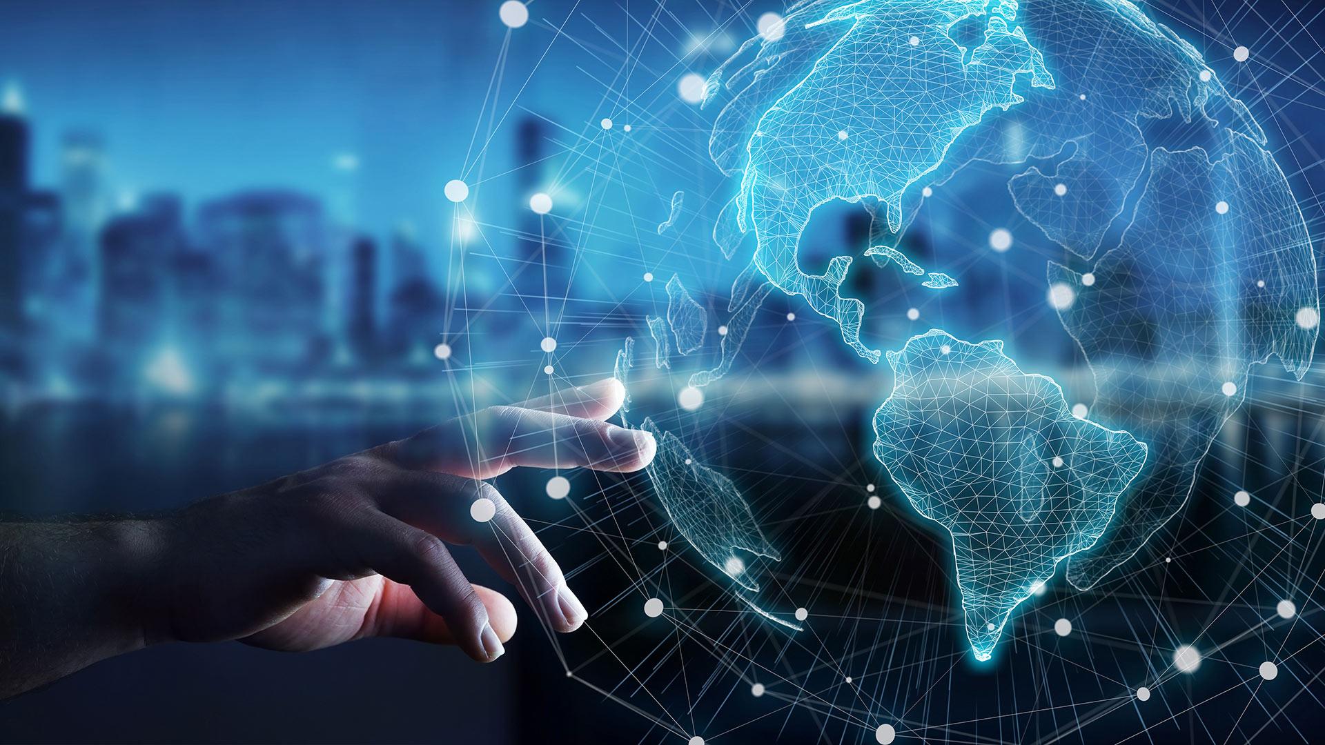 Hand touching virtual globe