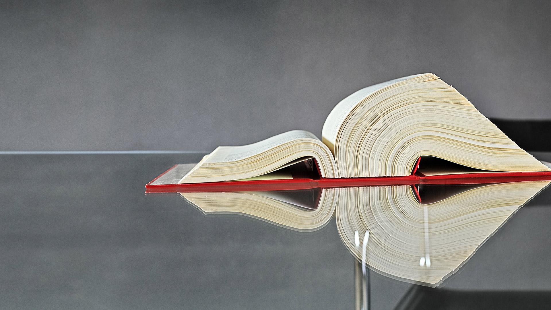 Large book on glass desk