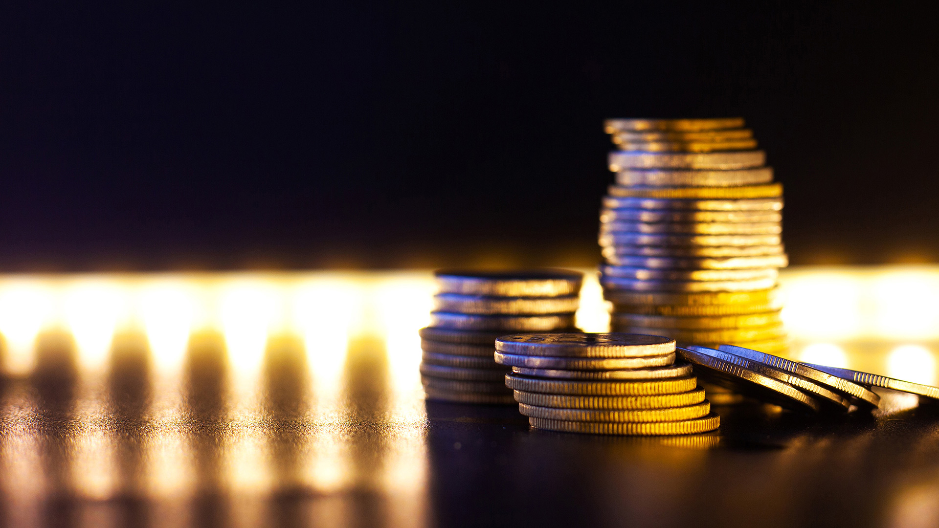 Stacked coins with bright lights